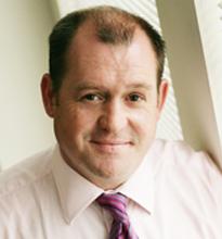 Photo of Glenn Harrison, Managing Director, Data Management Services